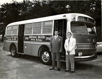 Bristol Brass Company workers standing next to a bus, at a summer outing celebrating the company's 100th anniversary