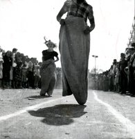 Children competing in a sack race at an outing of Bristol Brass Company employees celebrating the company's 100th anniversary