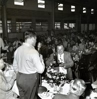 Man collecting a trophy at an outing of Bristol Brass Company employees celebrating the company's 100th anniversary
