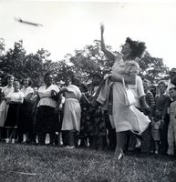 Participant in the rolling-pin throwing contest at an outing of Bristol Brass Company employees celebrating the company's 100th anniversary