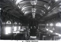 "Interior view of New Haven Railroad dining car 2303, ""Bronx,"" with ornamental arched windows"