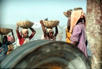 Girls Carry Heavy Baskets Of Rock At A Gravel Quarry