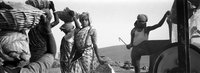 Girls Carry Heavy Baskets Of Rock All Day At A Gravel Quarry