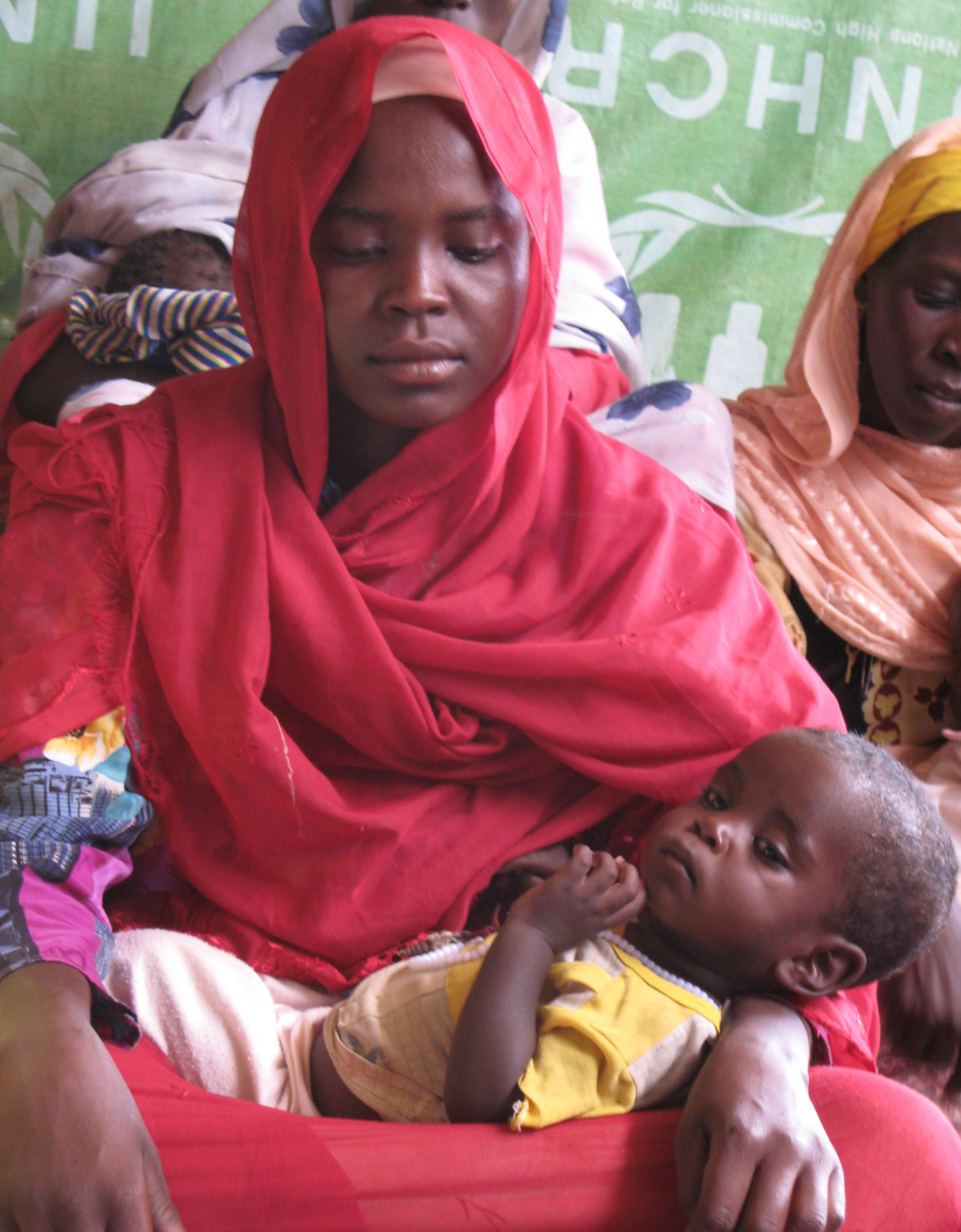 woman holds her baby at the Oure Cassoni refugee camp in Chad