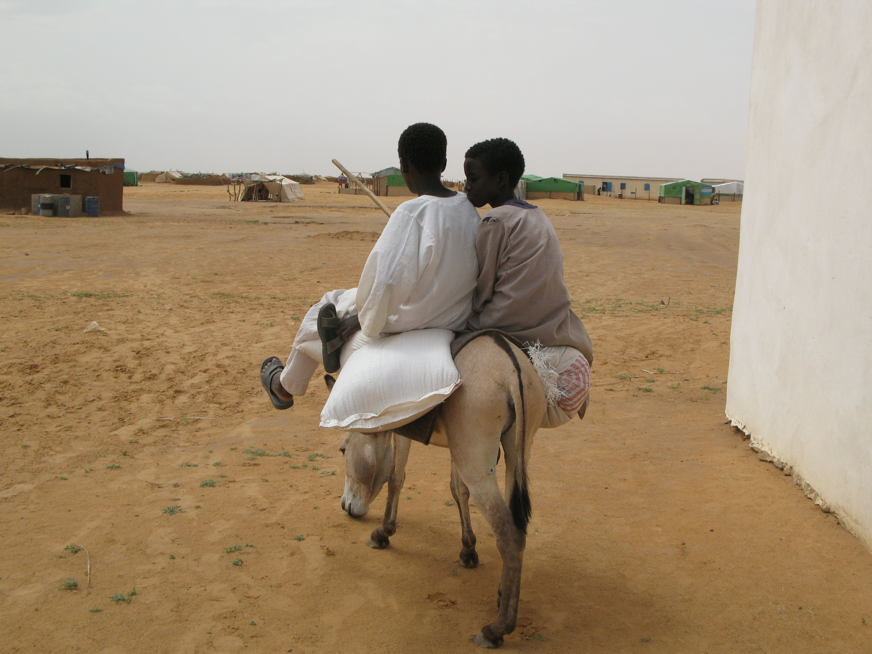 Two boys ride a donkey outside Oure Cassoni refugee camp in Chad