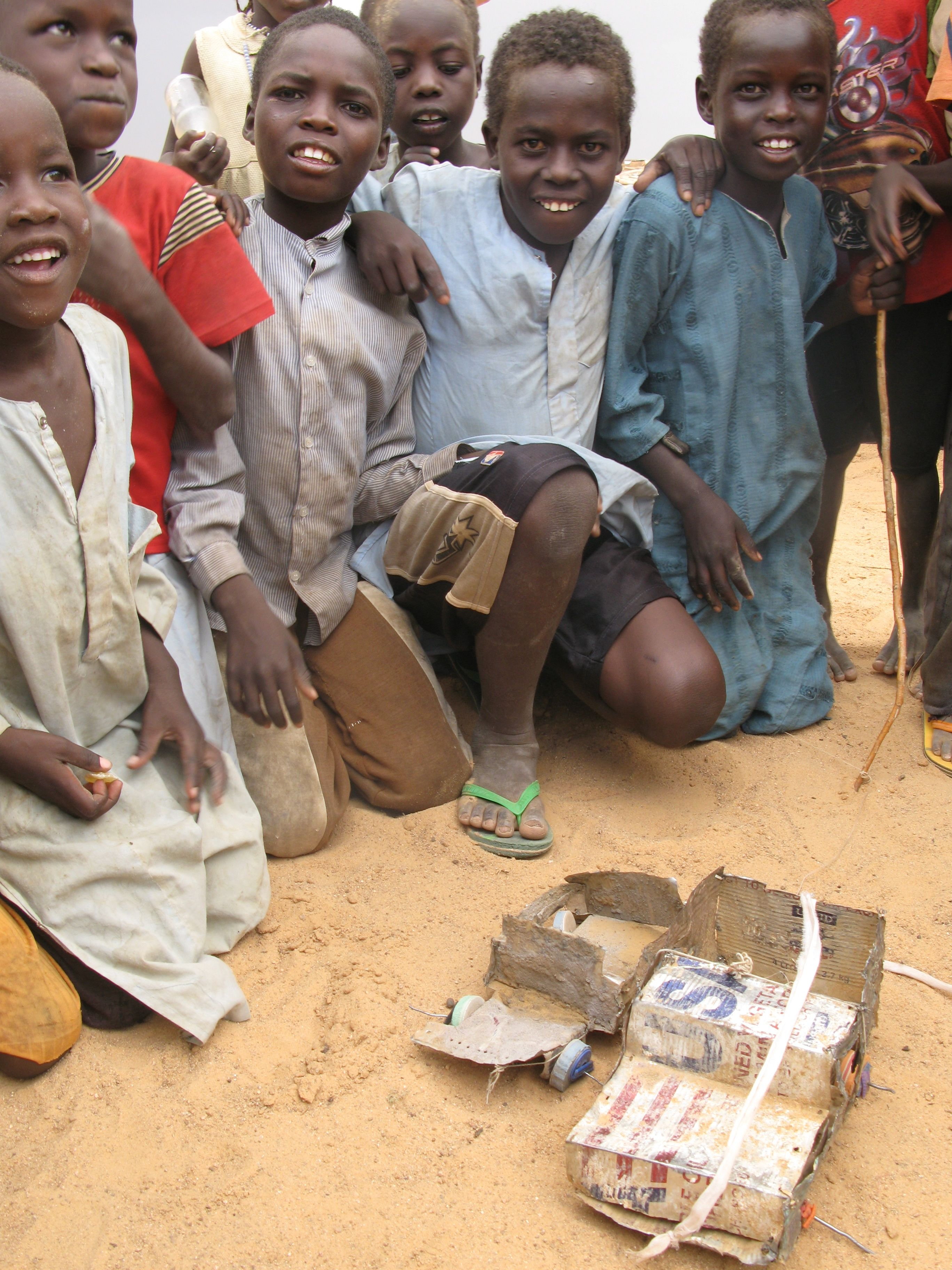 Children with homemade toys at a refugee camp in the Central African Republic run by the International Rescue Committee