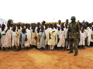 Darfuri boys with an African Union peacekeeping soldier