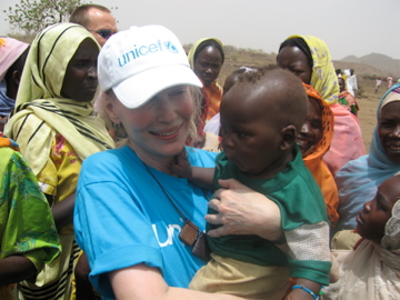 Actor and humanitarian Mia Farrow greets a Fur boy in the Jebel Marra mountains in Darfur