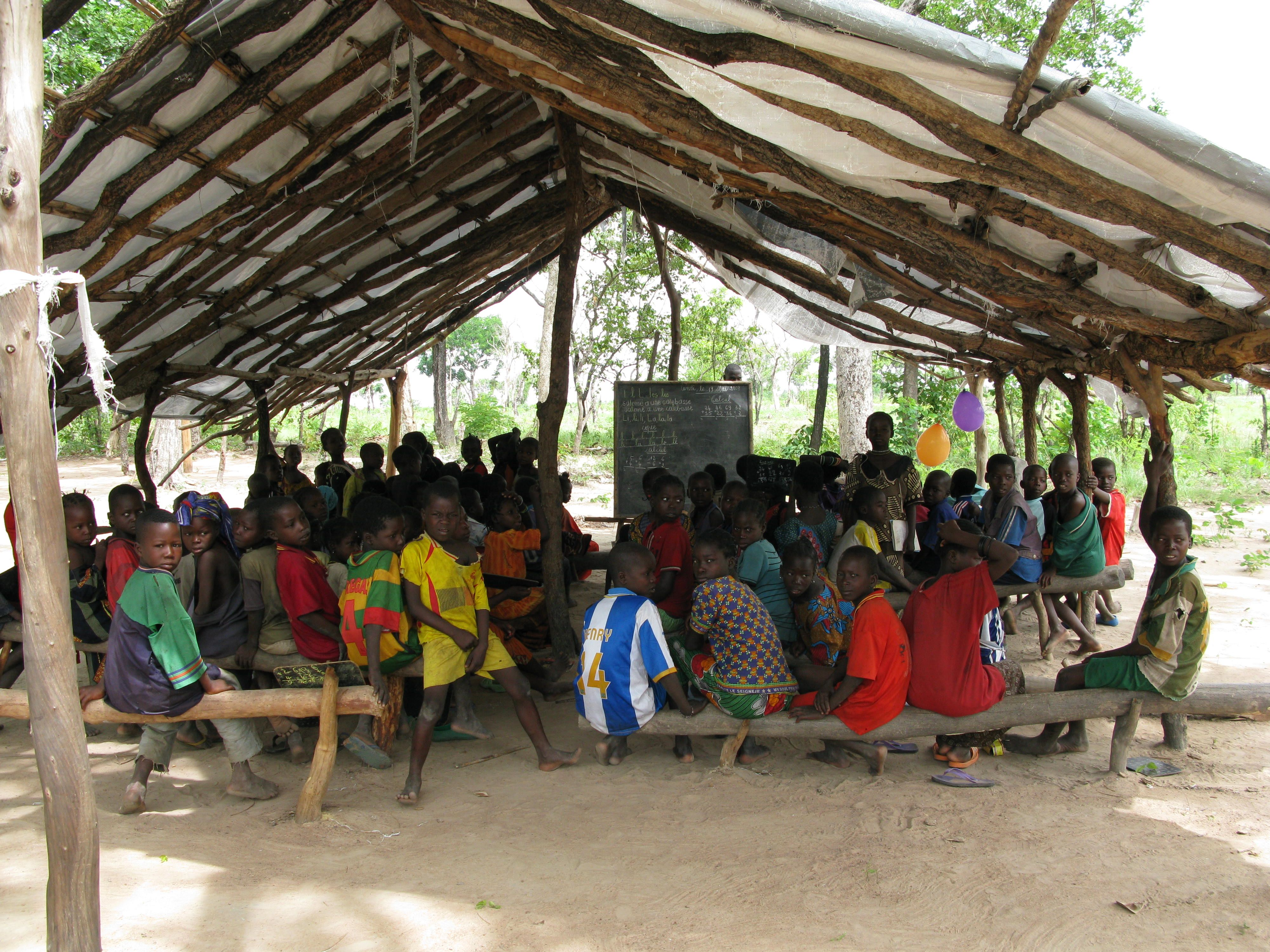 Darfuri children attend class at a bush school
