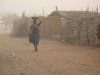 woman walking as a sandstorm approaches