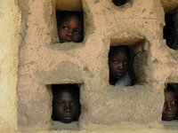 Children in the Central African Republic peek out of a window of a school along the border with Chad