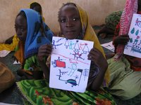 Darfuri girls in the Djabal Refugee Camp in Gasbeda, Central African Republic with drawings