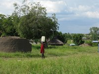 Girl carrying water in South Sudan