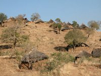 View of a hillside village in the Nuba Mountains, Sudan.