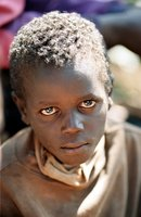 Young Boy's Face Reflects The Misery Of His Life Picking Coffee Beans