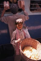 Child Sells Bread On A Train Platform