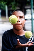 Boy Juggles Balls On The Street For Money