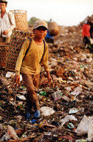Boy Roams The Dump Site