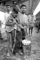 Street Children Sell Eggs At The Train Station
