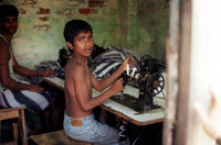 Boy Works With A Sewing Machine