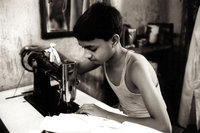 Boy Sews With A Sewing Machine
