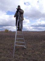 Robin Romano Filming Atop A Ladder For The Harvest Film
