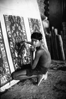 Underage Worker Working On A Tufted Rug