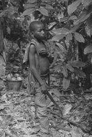 Boy Holding A Machete on Cocoa Farm