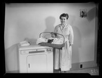 Handicapped Homemakers Project, Mrs. Wilson with laundry