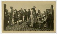 Passengers standing aboard steamship