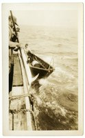 Crew members of the Doris M. Hawes hauling swordfish onto the schooner