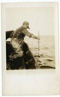Crew member of the Doris M. Hawes spearing swordfish