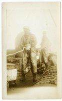 Crew members of the Doris M. Hawes hauling rope